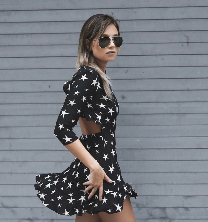 Danielle | Fashion Blogger from NYC She totally nailed the stars print dress with the cut out details on the waist!