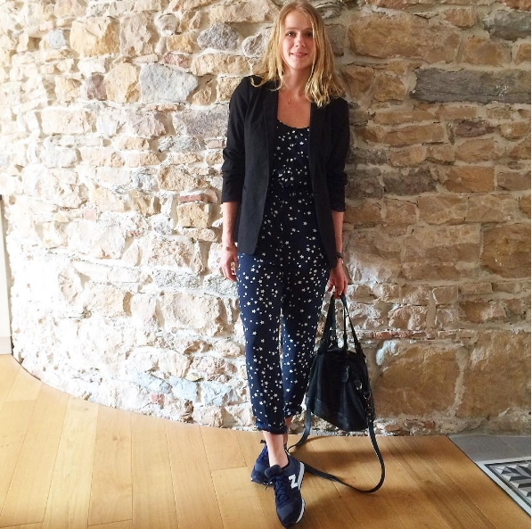 Leoleochou | France She created a comfy yet stylish look by styling her stars printed jumpsuit with a blazer and a pair of sne