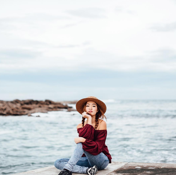 Christabel Chua She paired her burgundy offshoulder with a pair of denim jeggings and a pair of sneakers! I love how the braids and straw hat add the summer and road trip vibe!