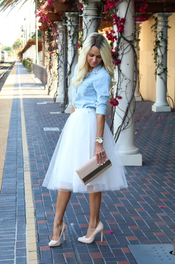 Jessica created the casual but very on point look by pairing a denim shirt with her white tulle skirt.