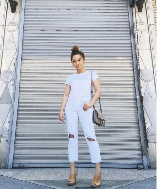 Jenn Im - Fashion Youtuber  She totally nail this stark white by pairing a basic white t with a pair of white boyfriend jeans!